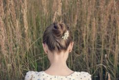 after-party hairstyles include accessorized bun looks.