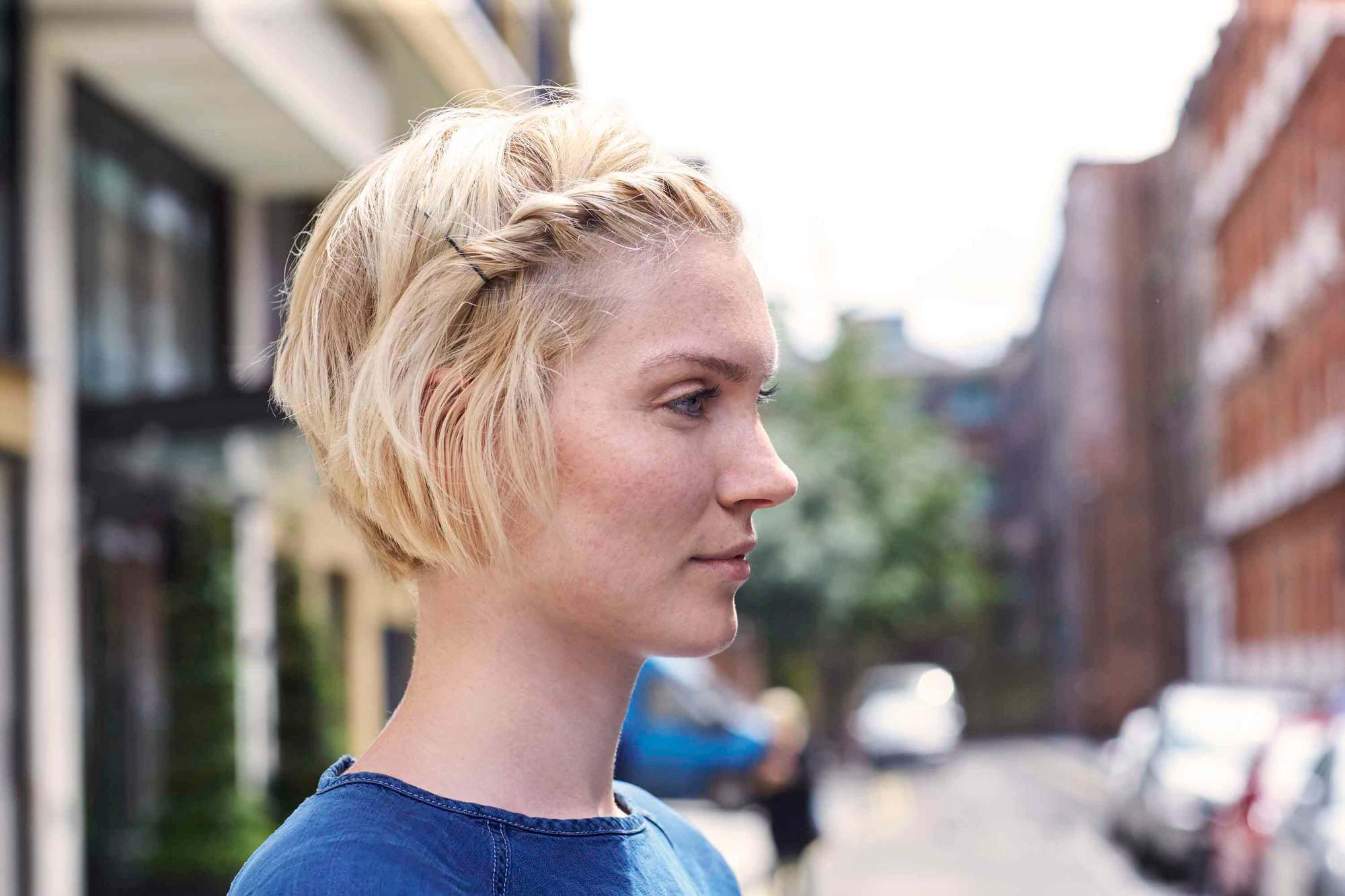 woman with accent twisted style on asymmetrical short hair
