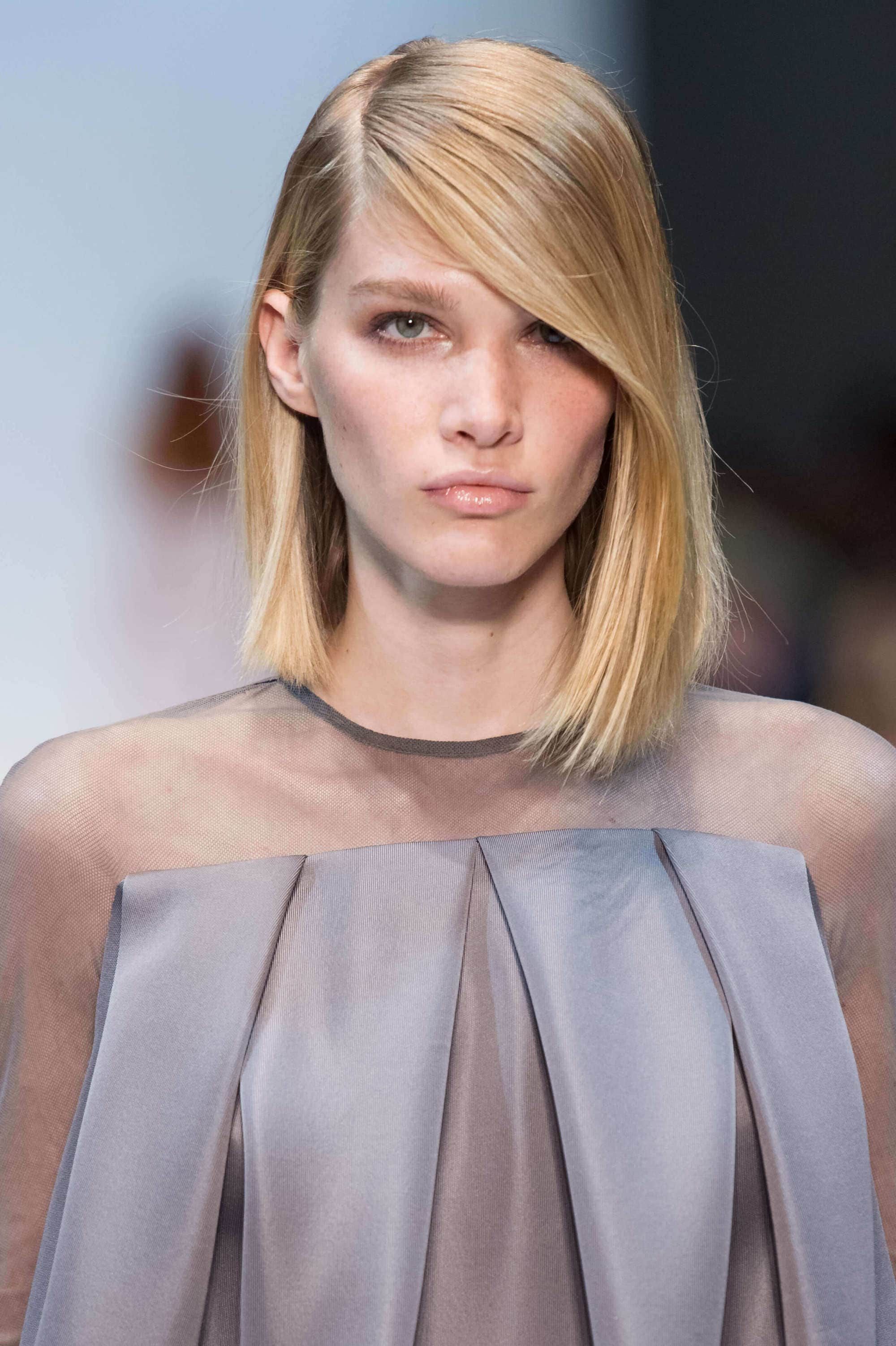 model with long asymmetrical haircut style on blonde hair