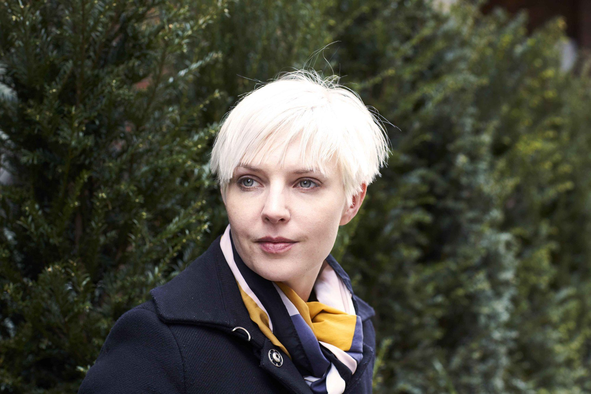 young woman with platinum blonde pixie short crop
