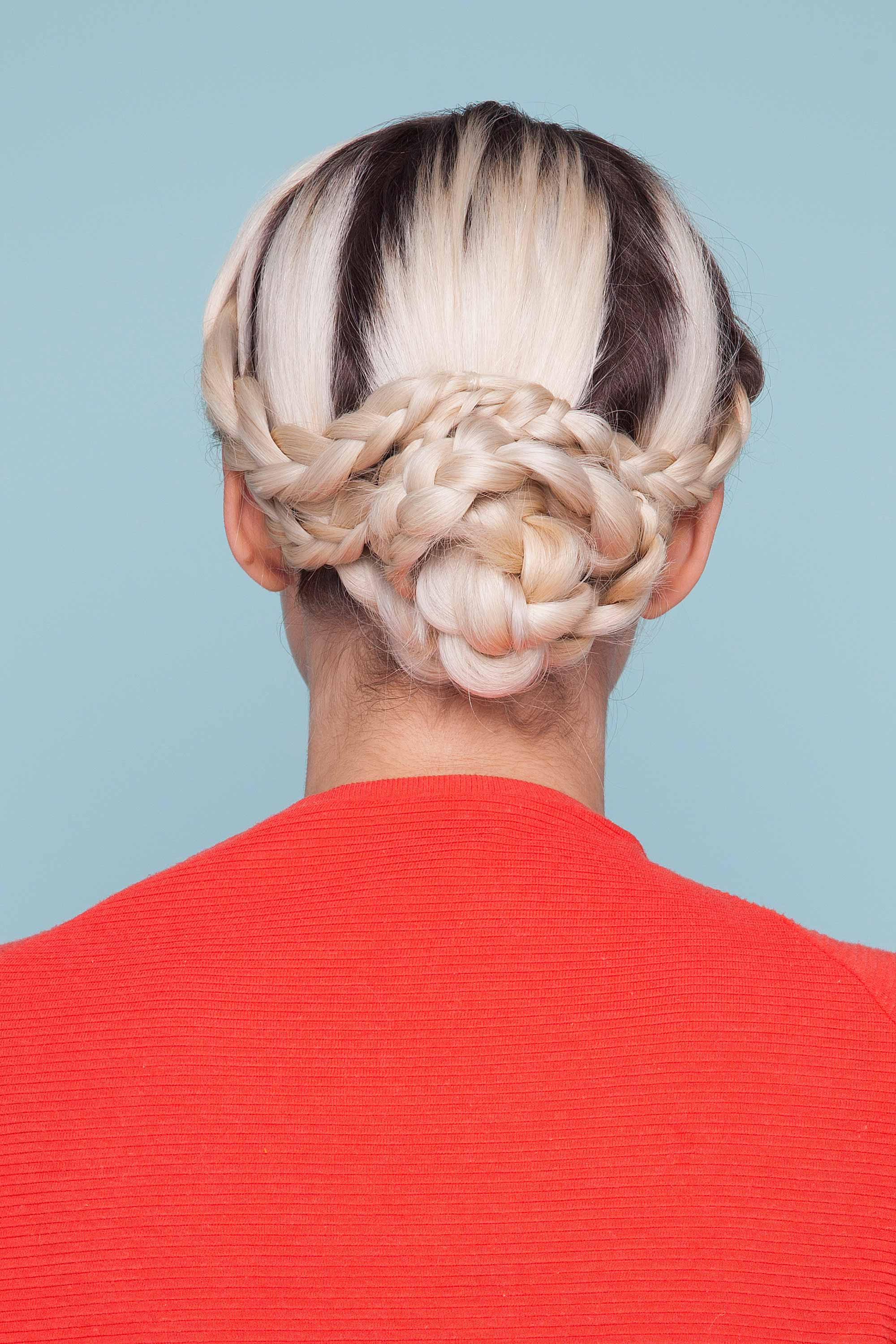 Woman wearing festival braids in an updo.