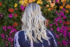 festival season hair products on long blonde wavy hair