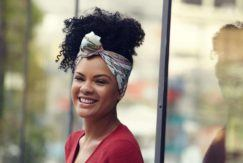 young woman with pineapple updo and frizz on natural hair