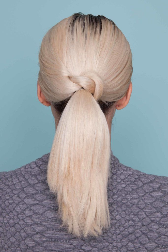 Woman with platinum blonde hair - how to wear platinum blonde hair with a knotted ponytail