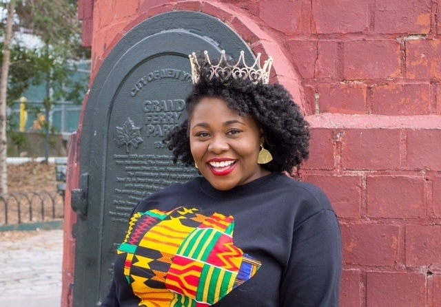 Afika James with loose natural hair twist out style for International Women's Day 2017