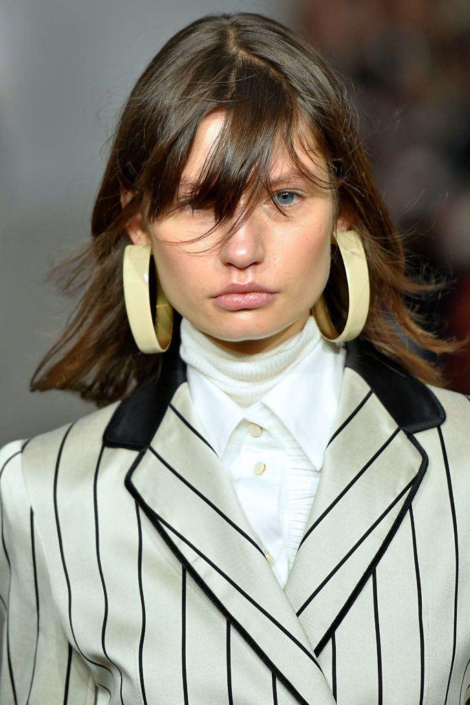 medium layered hairstyles with a fringe brunette flip