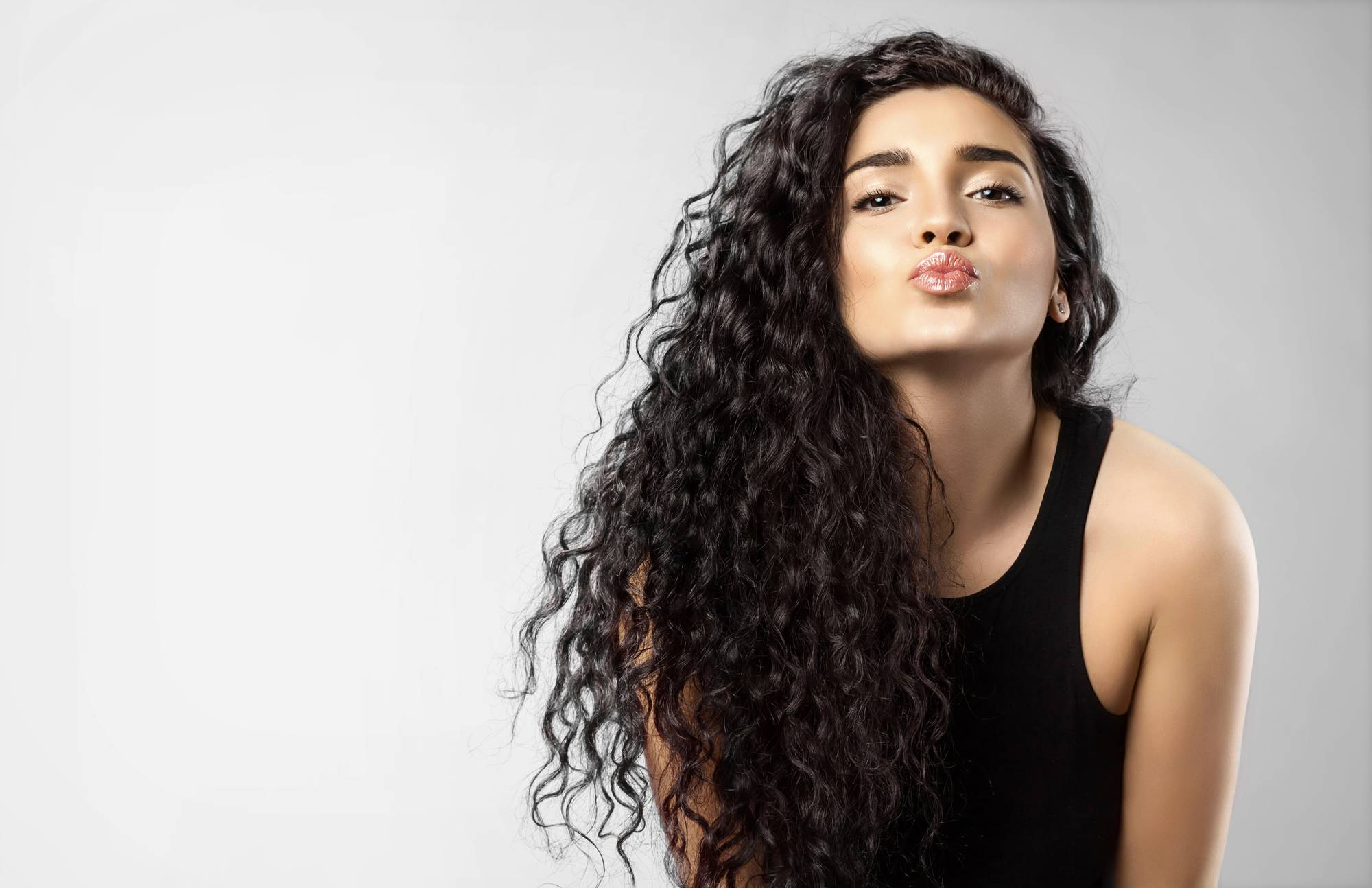 tight coils are new hairstyles for spring we love