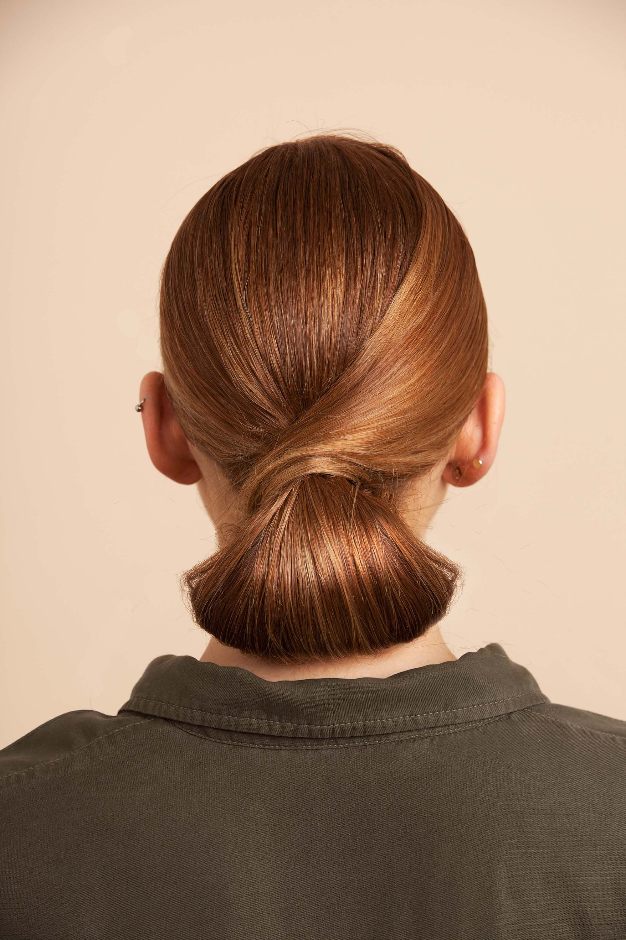 twisted updos are some of our fave new hairstyles for spring