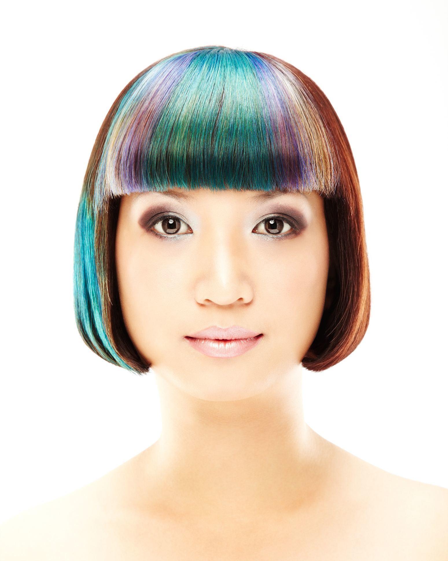 Woman with oil slick hair streaks in brown hair.