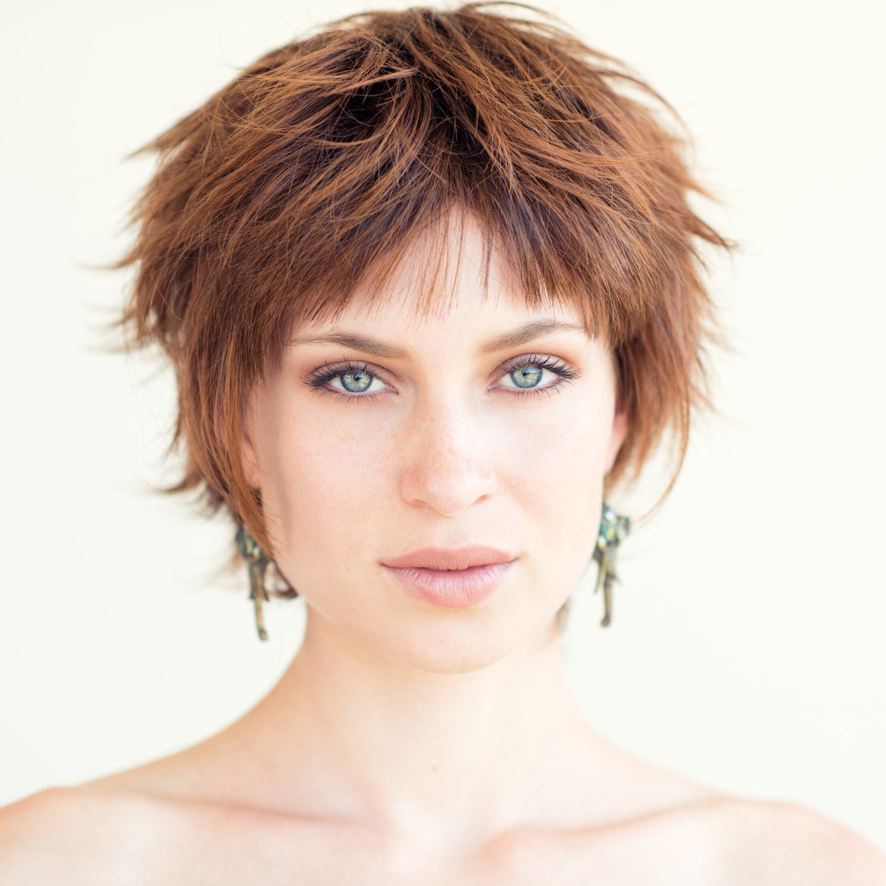 when it comes to funky hairstyles for short hair, opting for a feathered pixie as demonstrated by this istock model is great