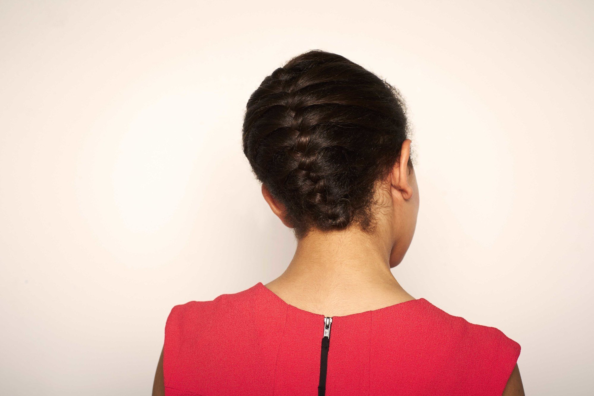 Brunette Woman Wearing Shoulder Length Hairdos Tucked Braid Updo