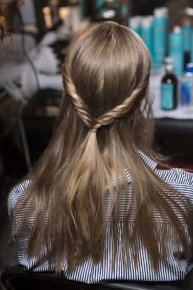 sleek hair trend for spring with hair twists
