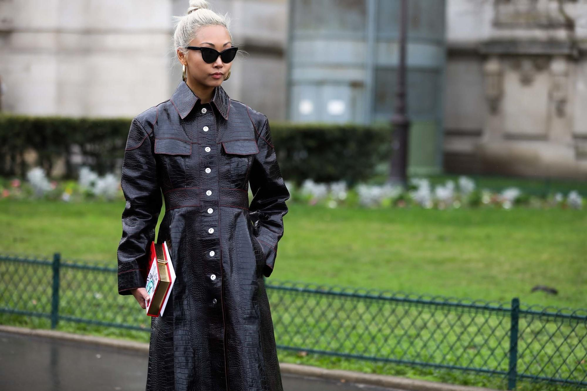 young asian woman with platinum blonde sleek top knot hairstyle