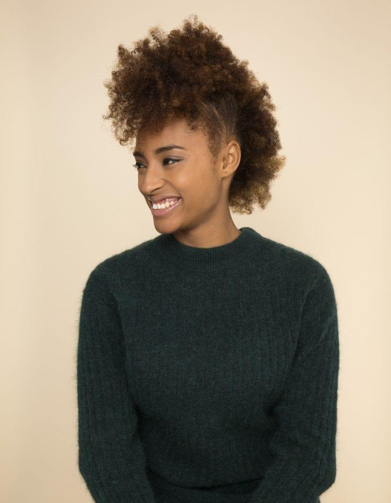 Woman wearing cute spring break hair looks: natural frohawk.
