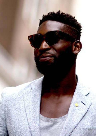 Spring Hairstyles For Black Men include high top undercuts.