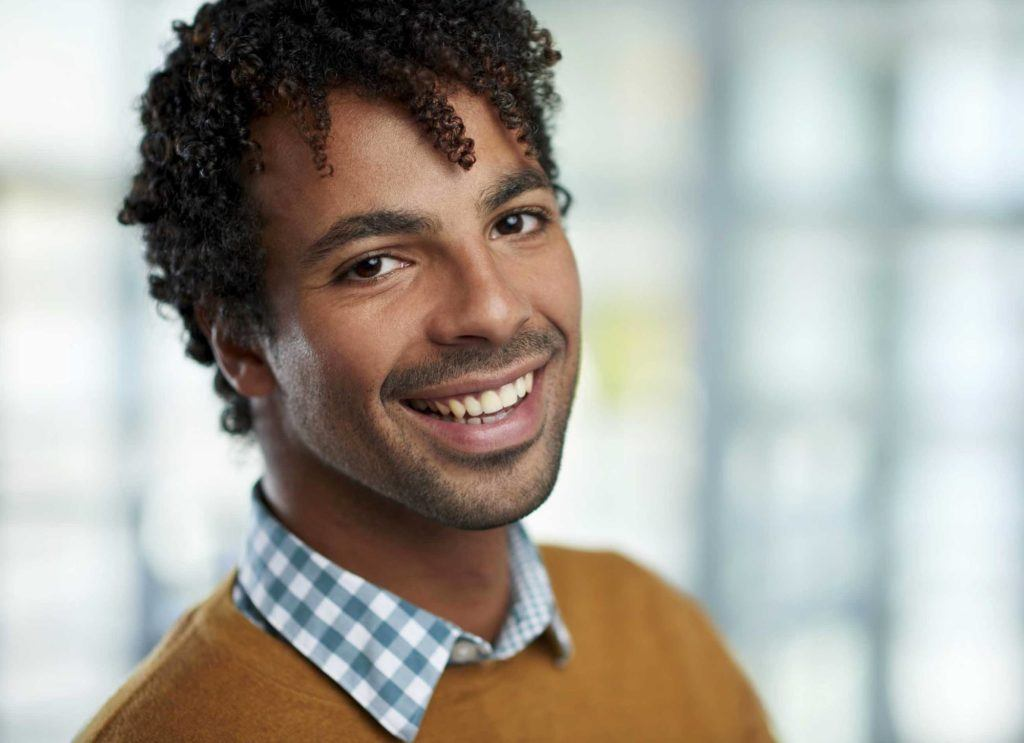 Spring Hairstyles For Black Men include natural dreads.