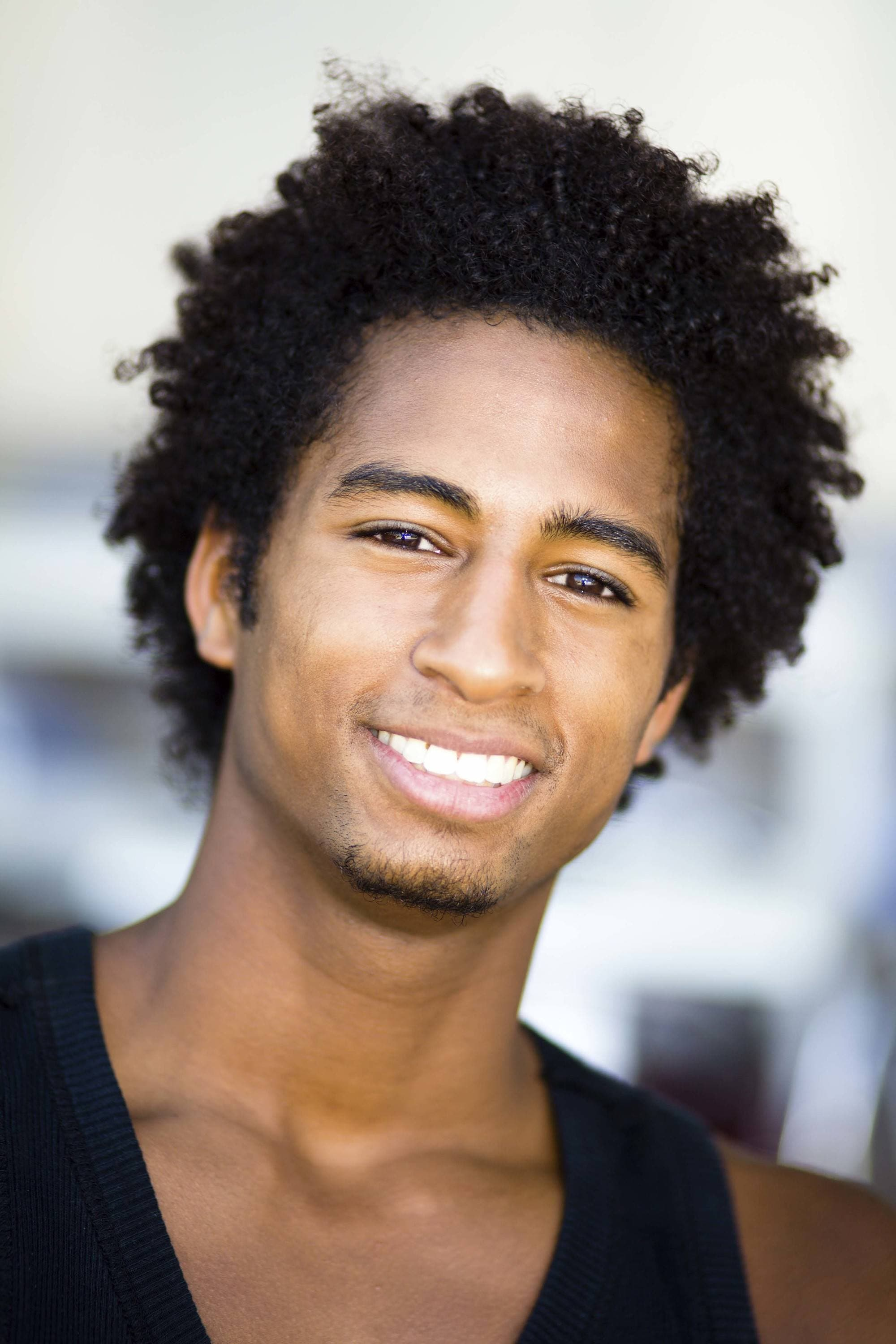 style men's curls in an afro style