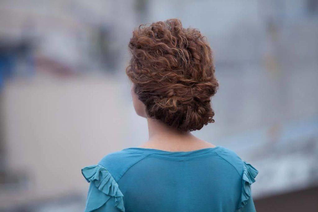 Messy Bun styles are one of the easiest Wedding Updos For Curly Hair Types To Try