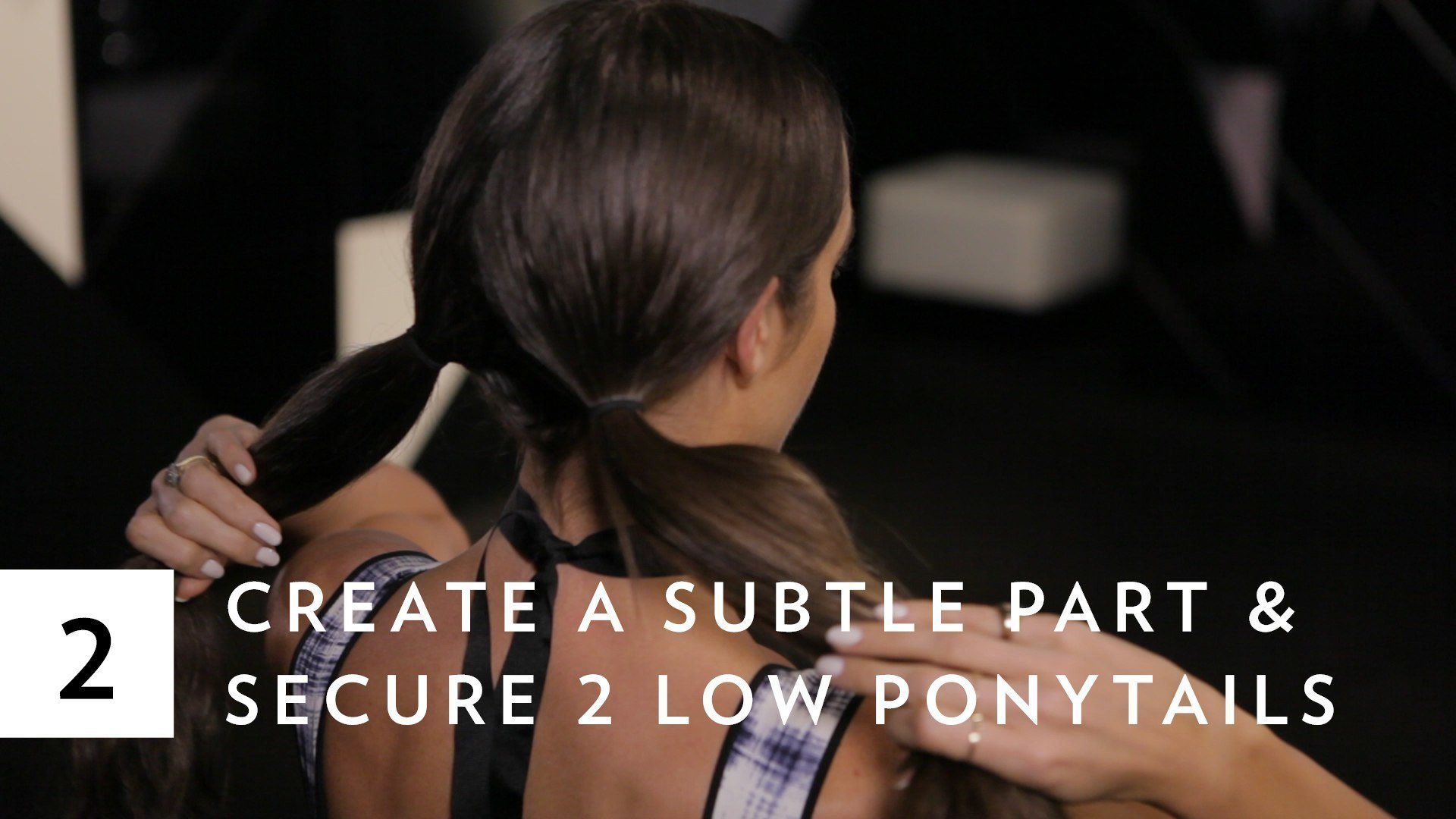 double braid bun twist tutorial: Louise Roe holding her pigtail ponytails