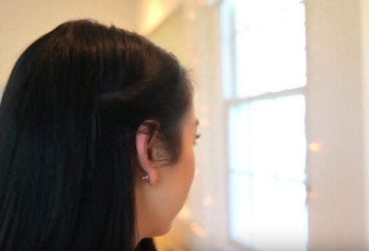 fun straight hairstyle twisted hair to the side back view