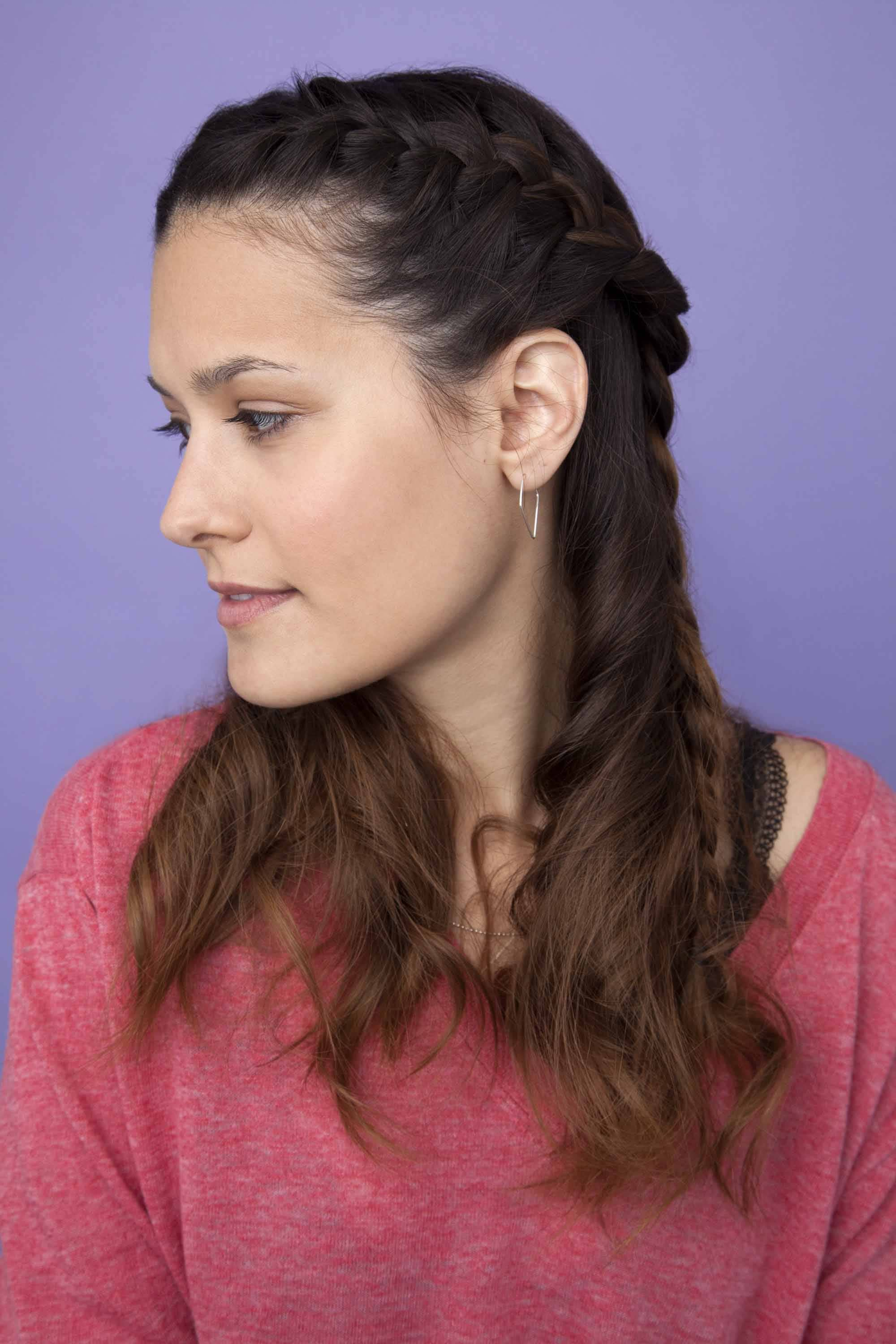 half up half down braid: young woman with side braided hairstyle on long dark brown hair