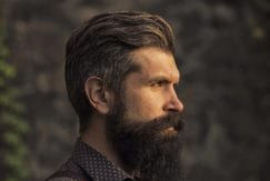 men's grey hairstyles: side view of pompadour hairstyle on salt and pepper hair