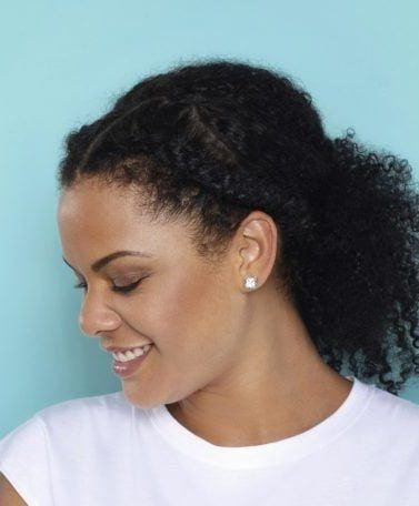 natural braided hairstyles tutorial. woman showing side view of hair