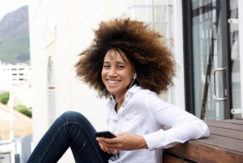oil rinse natural hair: young woman with big natural hair wash and go style