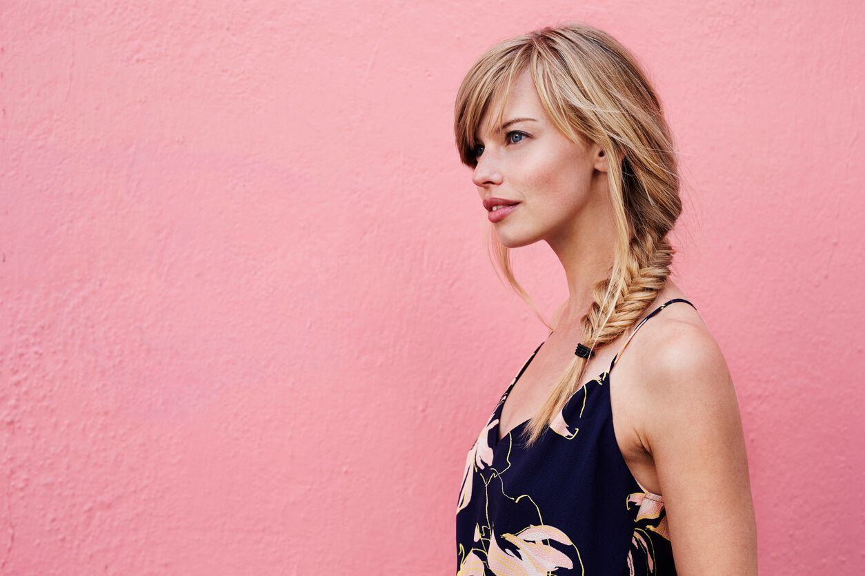 side braid hairstyles: side bangs with side fishtail braid on long blonde hair
