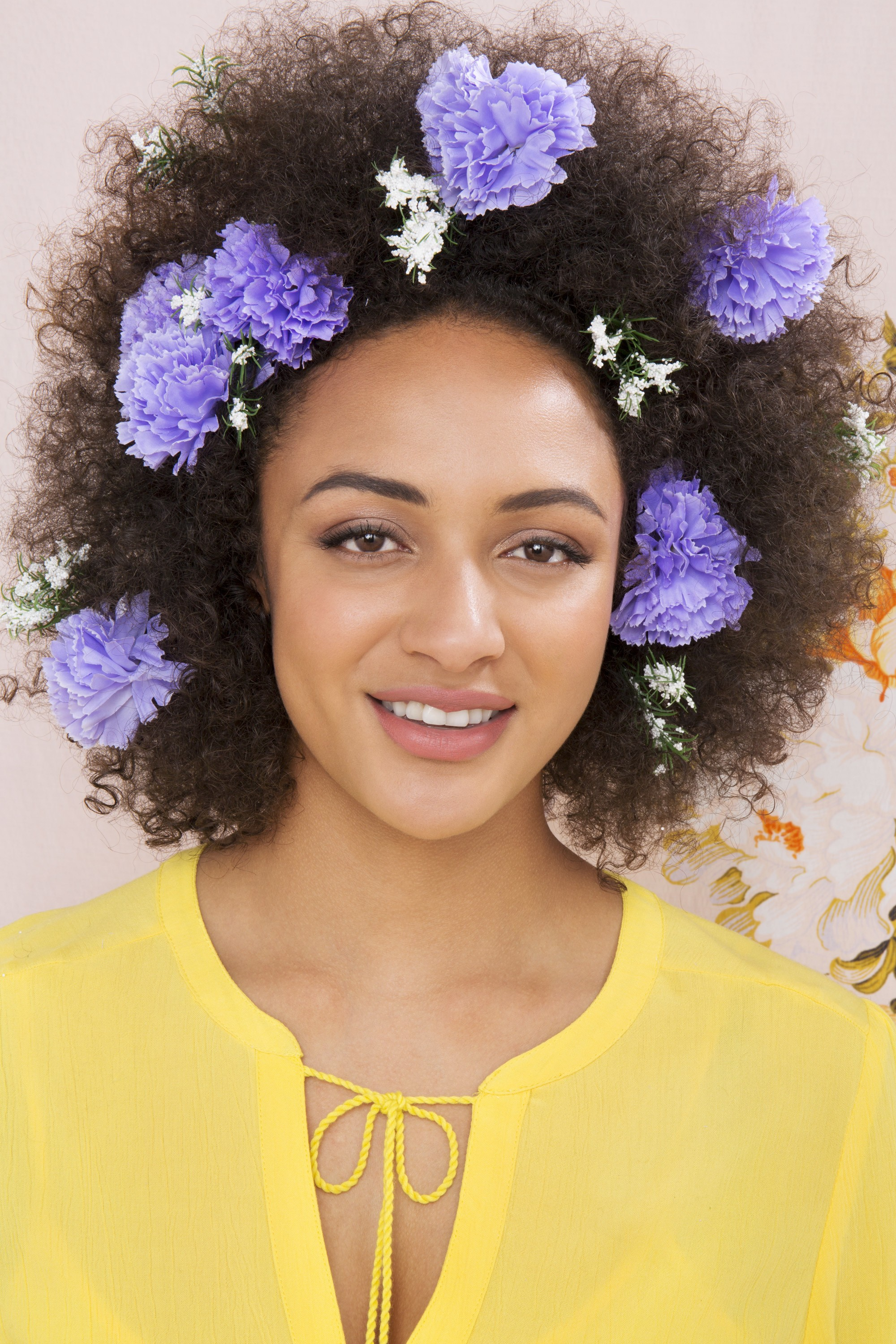 floral afro hair: carnation and babies breath