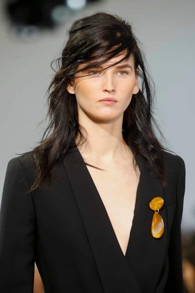 side bangs in a half-up hairstyle