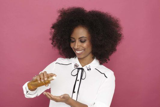side pinned hairstyle for natural hair add oil for shine