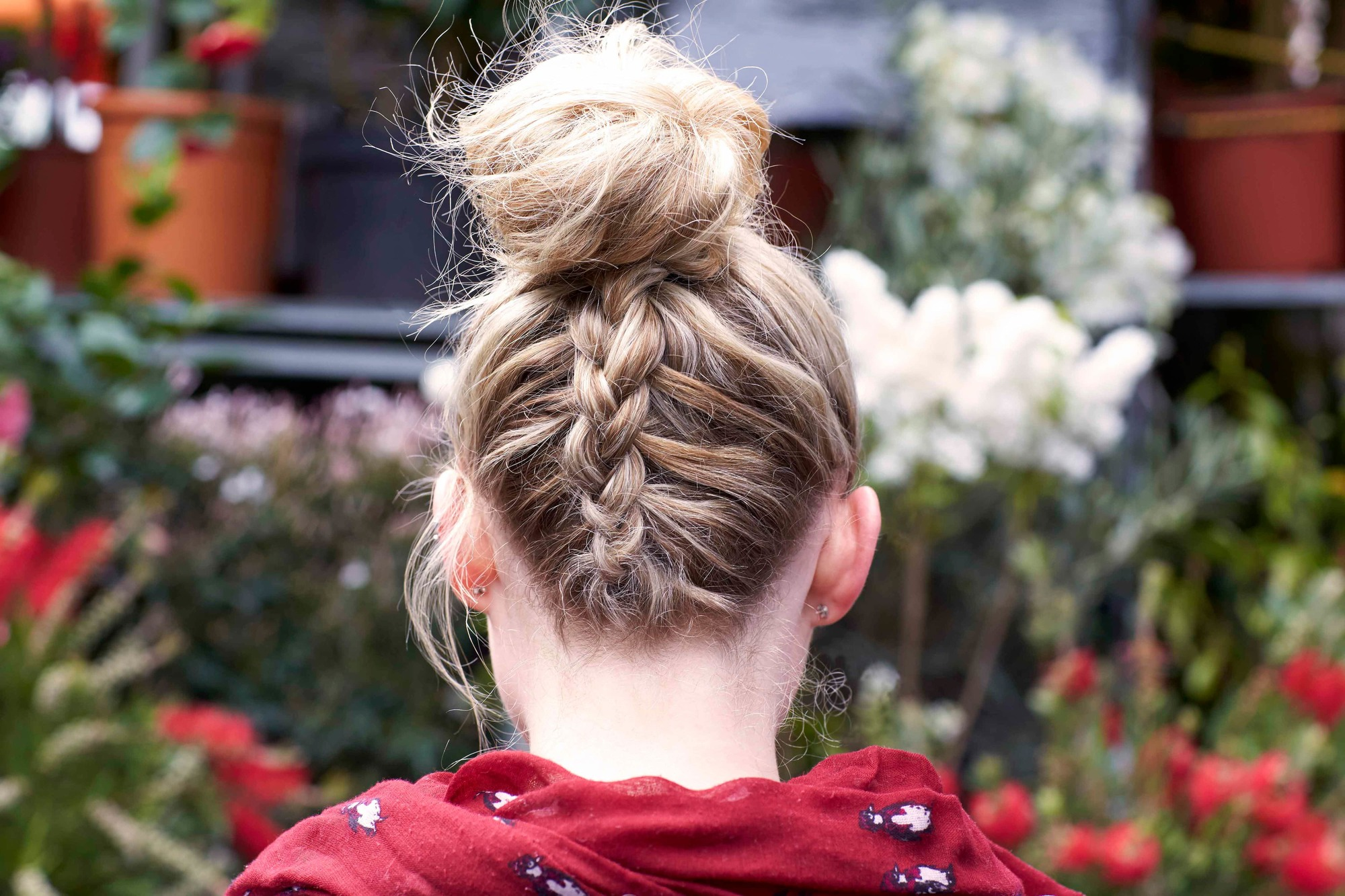 messy bun with upside down braid