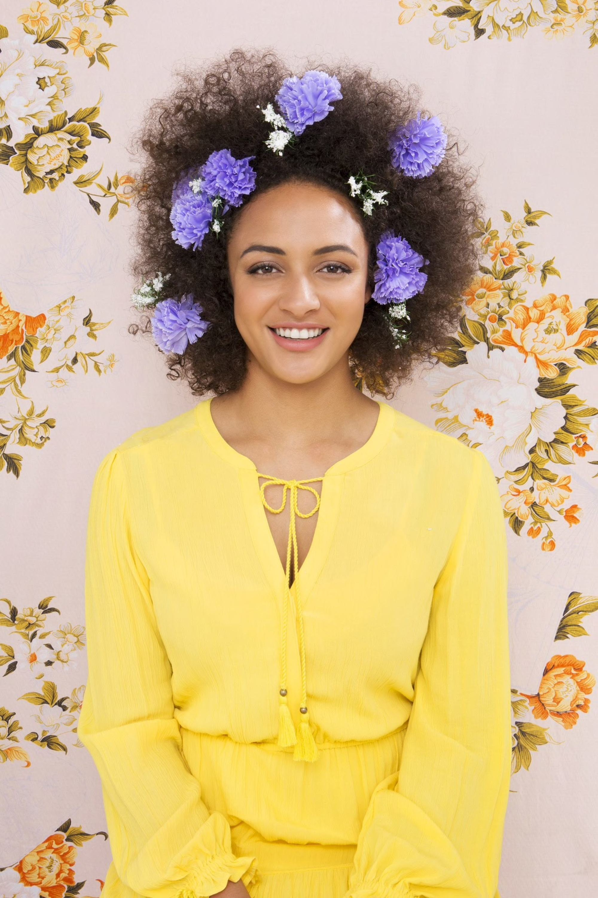 afro hairstyles with flowers