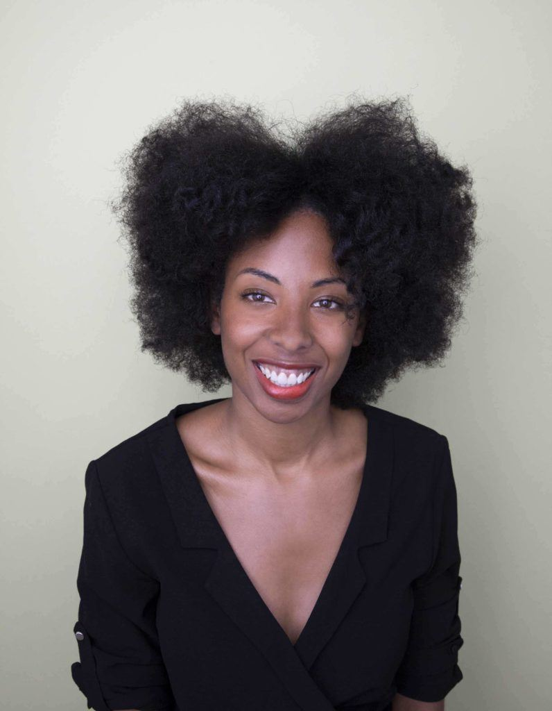 Change up your 'fro shape by adding a center part. Photo credit: Verity Jane Smith