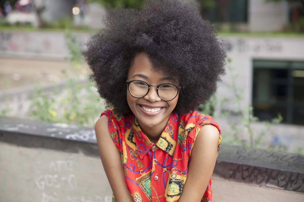 A gorgeous full afro is an awesome style to try. Photo credit: Allyson Alapont