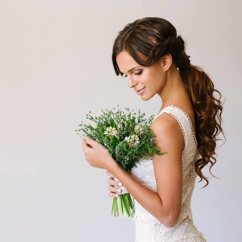 bridal hairstyles low wavy ponytail