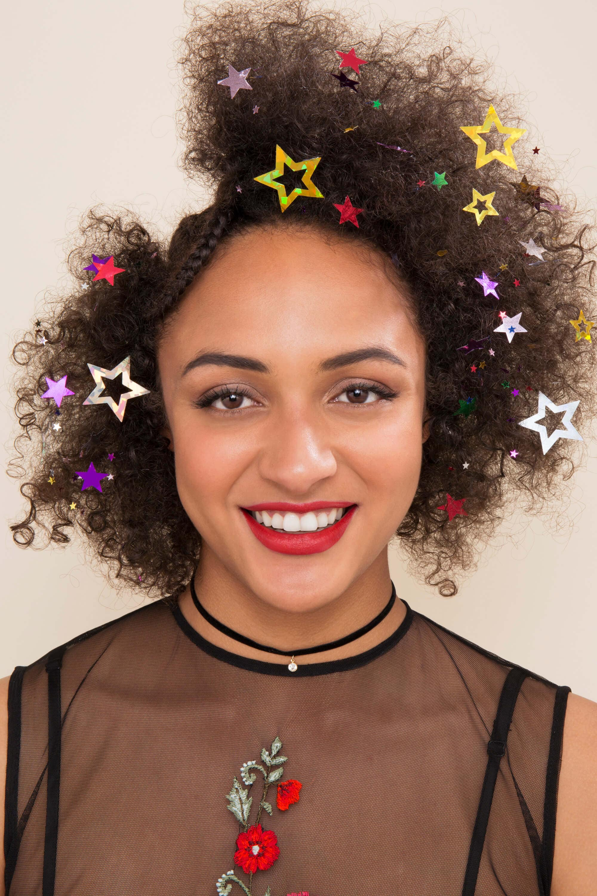 sequin hair with star sequins on afro