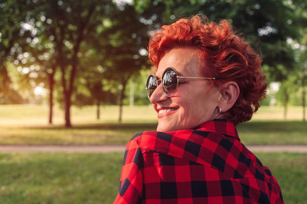 spring hair colors: older woman with scarlet hair