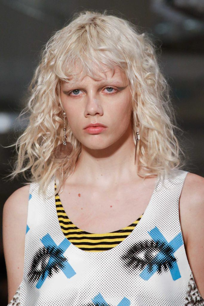 tightly textured layered haircuts with bangs