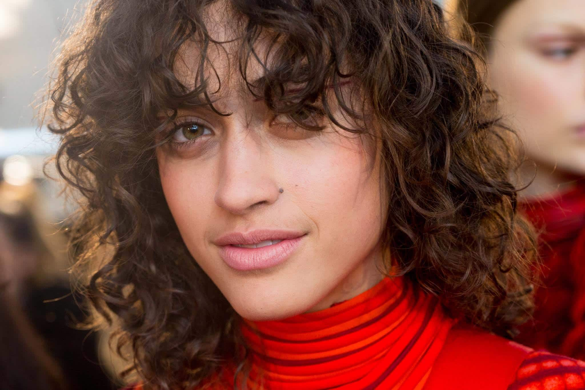 wet curly layered haircuts with bangs