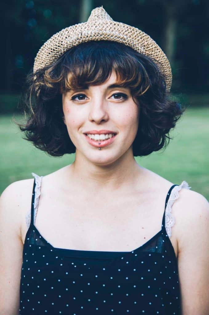 wavy hair with bangs bob: hat accessory