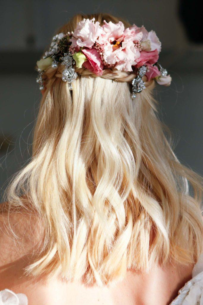 floral barrette half up half down wedding hairstyles