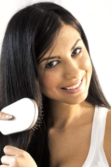 straightening serum: brushing hair