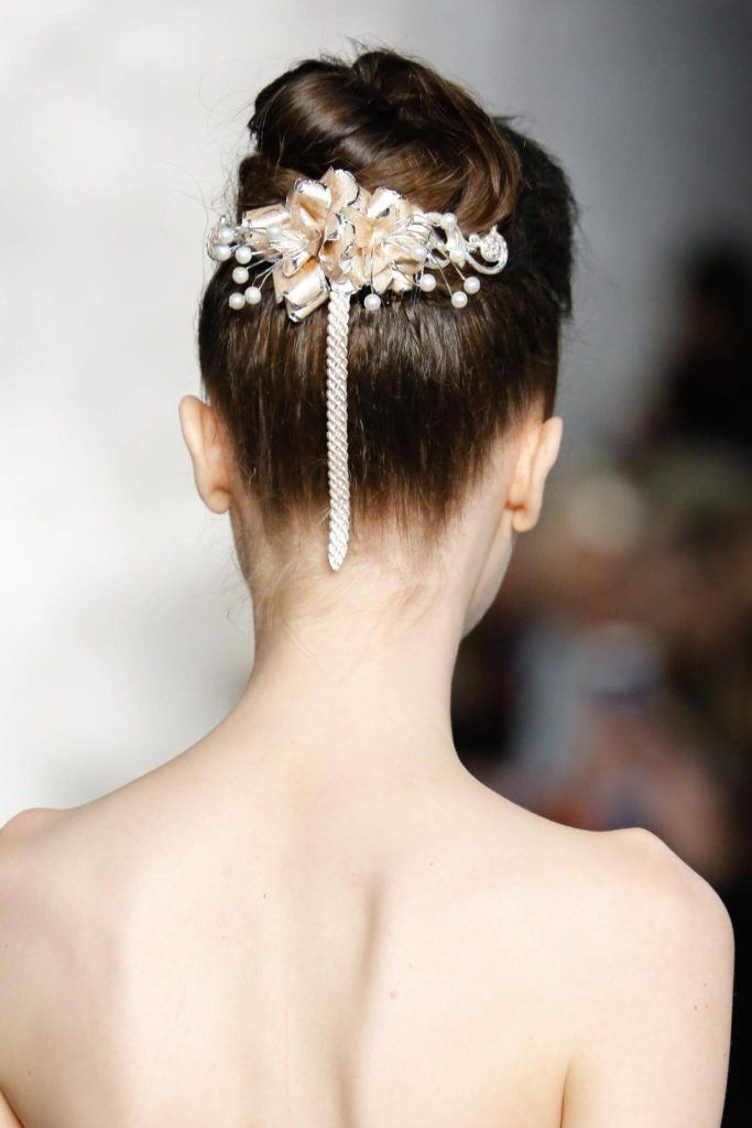 rear view of a woman on a runway with ribbon on her hair