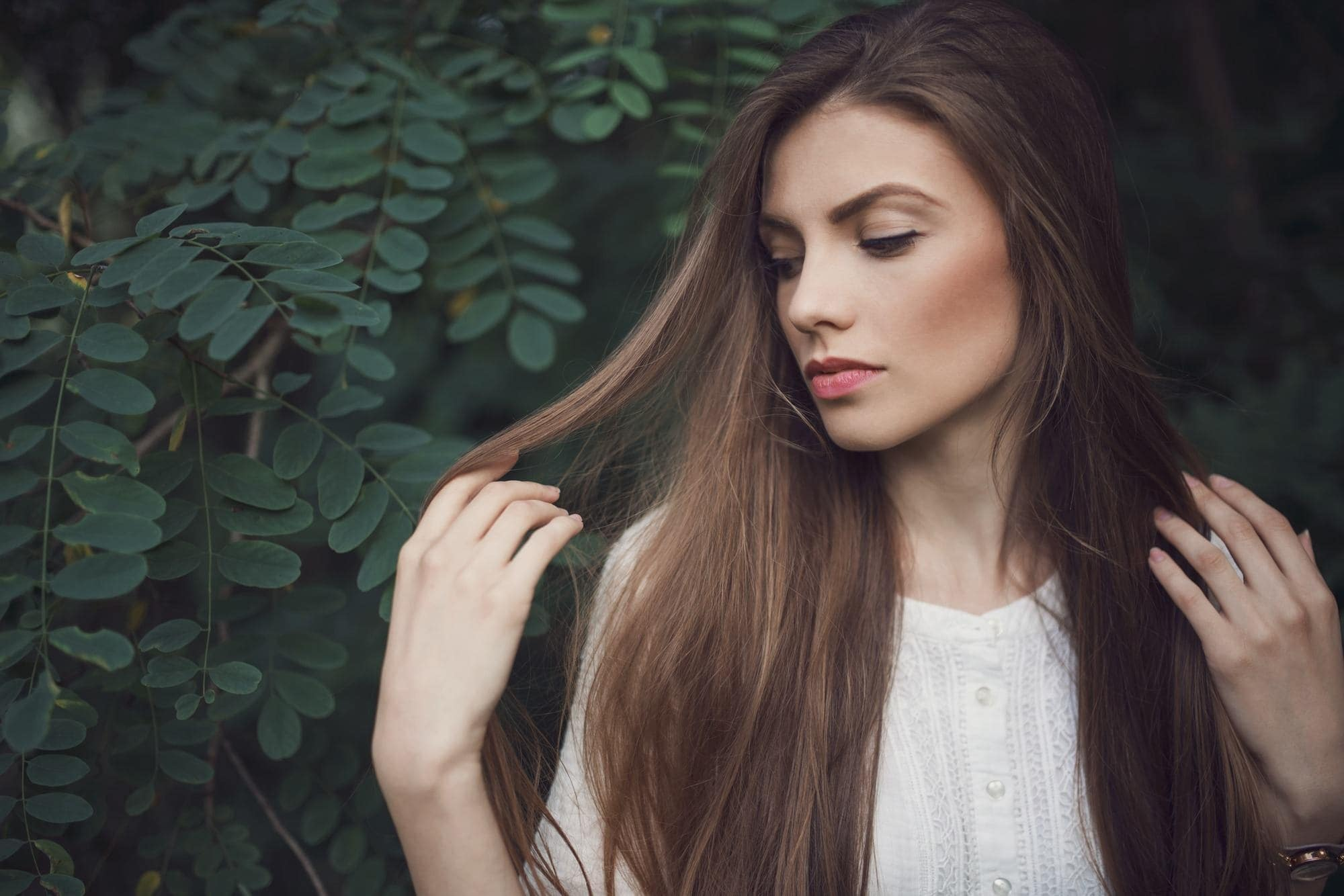 best dry shampoo for oily hair: woman looking at long brown hair