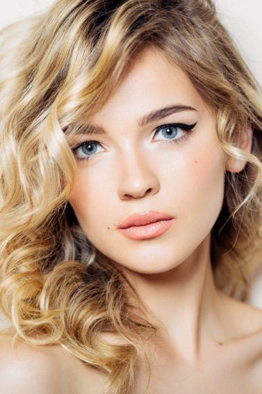 blonde hair spray curly medium length hair