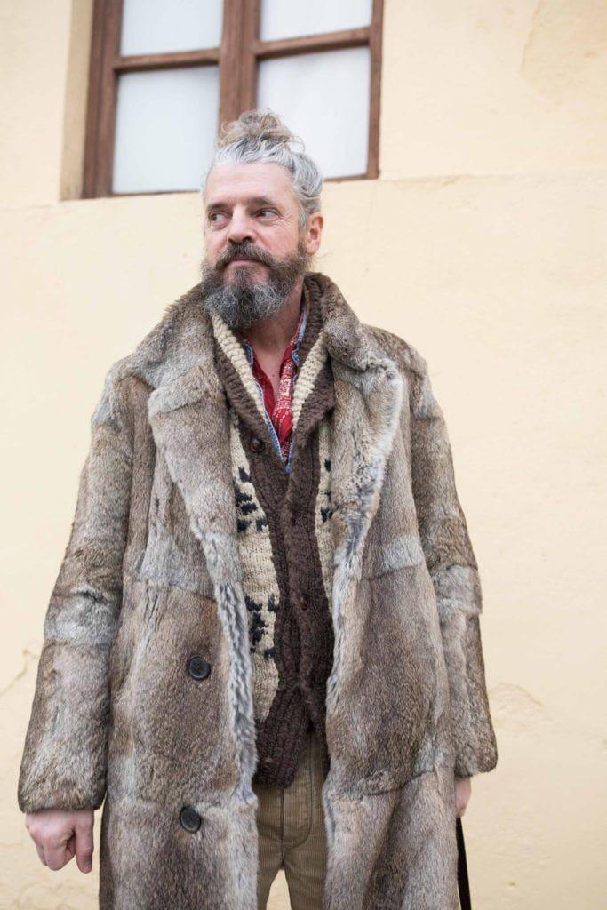 man bun and beard: gray hair