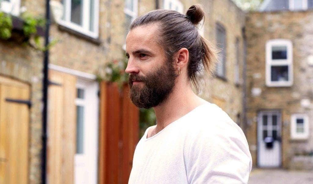 man bun and beard: half tuck