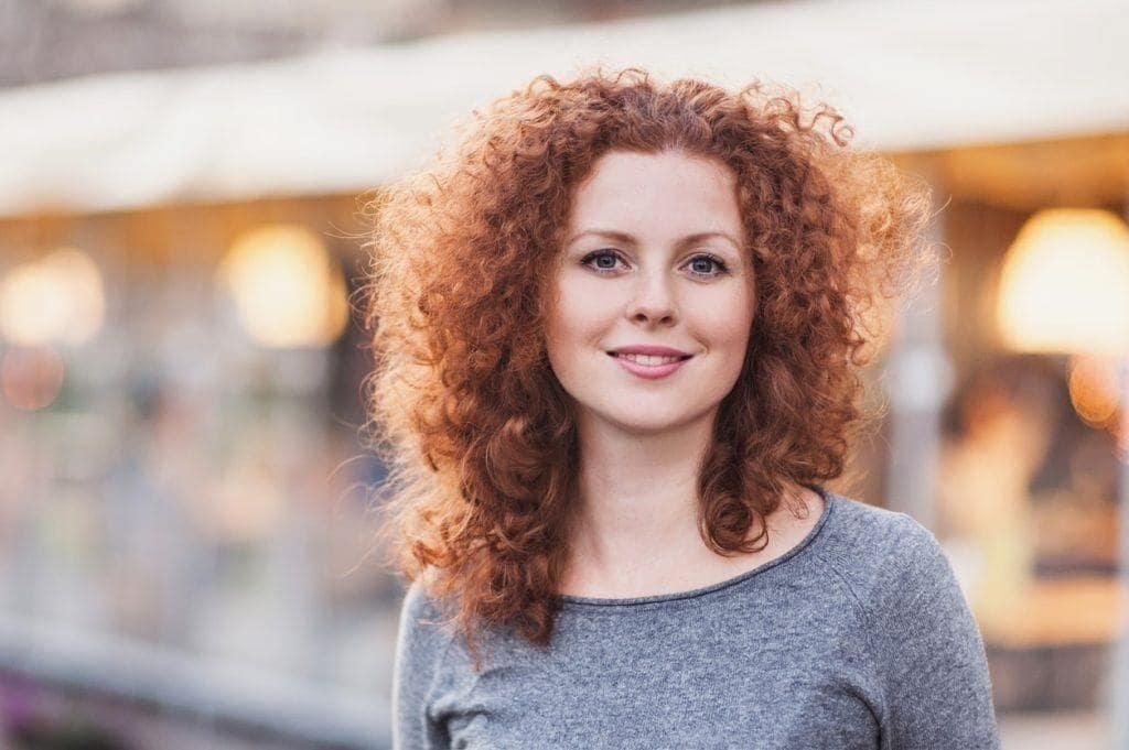 curly haircuts for round faces long layers